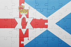 puzzle with the national flag of northern ireland and scotland . concept