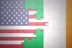 puzzle with the national flag of united states of america and ireland.concept