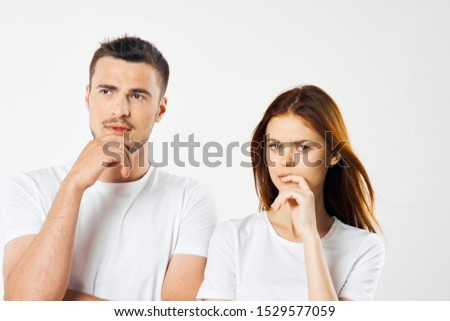 Puzzled look beautiful red hair woman and young brunette man looks away