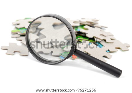 Puzzles and magnifier