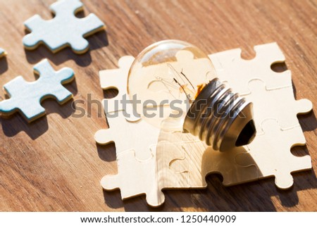 Puzzles with light bulbs, problem solutions and teamwork, creative key ideas