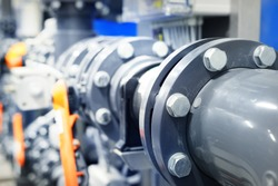 PVC pipeline an industrial city water treatment boiler room. Valves and pipe conections.