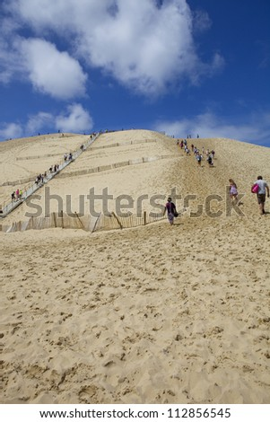 PYLA SUR MER, FRANCE - AUGUST 8: People visiting the Famous dune of Pyla, the highest sand dune in Europe, on August 8, 2012 in Pyla Sur Mer, France.