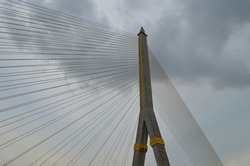 Pylon and cables of the Rama VIII Bridge in Bangkok, Thailand, seen from below