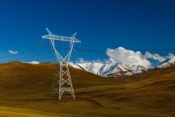 pylons of high-voltage power lines in the mountains, kyrgyzstan, energy landscape