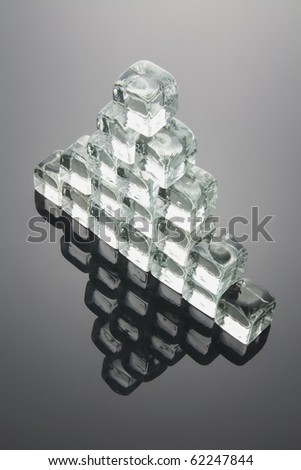 Pyramid Formed by Ice Cubes with Reflection