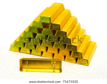 pyramid from gold bullions - stock photo