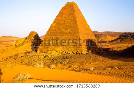 Pyramid in sand desert view