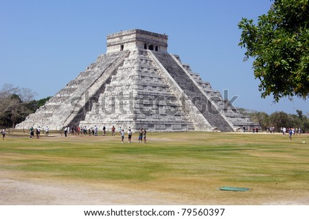 Pyramid Kukulkan and tourists on the square in Chichen Itza, Mexico