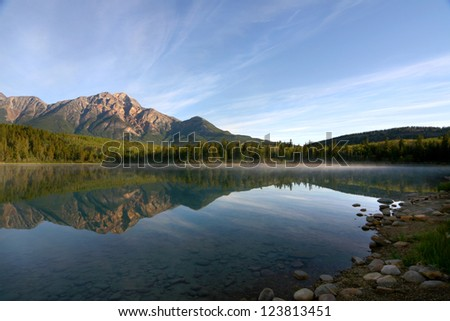 Pyramid Mountain Reflected in Lake on Calm Morning