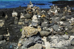 Pyramid of basalt stones stacked on the beach of Jeju Island