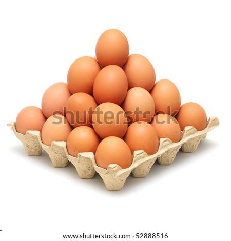 pyramid of brown eggs isolated on white background
