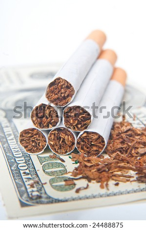 pyramid of cigarettes laying on money