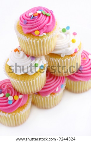 stock photo : Pyramid of 6 cupcakes with pink and white icing