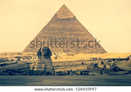 Pyramid of Khafre (Chephren) and Great Sphinx of Giza, famous egyptian landmarks in Cairo. Sphinx is a mythical creature with lion body in ancient culture of Egypt and oldest monumental sculpture. #526410997