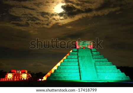 Pyramid of  Kukulkan, Chichen Itza, shot under the full moon during a special light show.