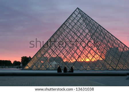Pyramid of Louvre - Paris - sunset - stock photo