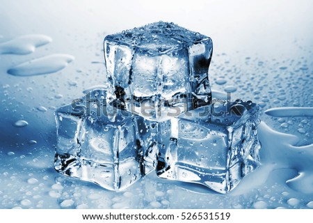 Pyramid of melted ice cubes with drops