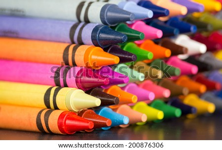 pyramid of multicolored new crayons bright closeup