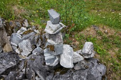 pyramid of stones on a block of stone in the forest.