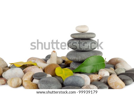 Pyramid of the round sea stones with leaves isolated on white background Foto stock ©