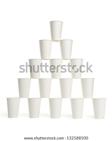 Pyramid of white disposable paper cups isolated on white background