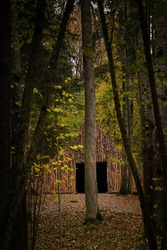 Pyramid of Wishes. Wooden pyramid in the mysterious Pokaini Forest near Dobele, Latvia during cloudy autumn day