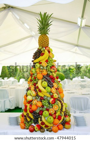 pyramid with tropical fruit on the wedding banquet