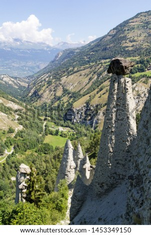 Pyramides d'Euseigne or fairy chimney rock formations in Swiss Alp. Rocks stay in balance on eroded former glacier moraine. A road pass was built under geological formation. #1453349150