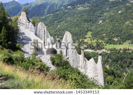Pyramides d'Euseigne or fairy chimney rock formations in Swiss Alp. Rocks stay in balance on eroded former glacier moraine. A road pass was built under geological formation. #1453349153