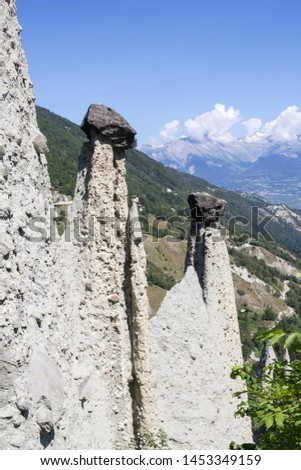 Pyramides d'Euseigne or fairy chimney rock formations in Swiss Alp. Rocks stay in balance on eroded former glacier moraine. A road pass was built under geological formation. #1453349159