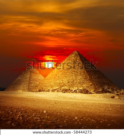 Stock Photo Pyramids in Giza valley under sunset light