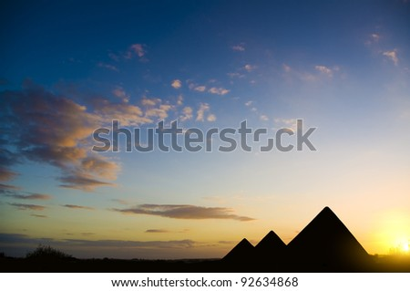 Pyramids in Giza valley under sunset light