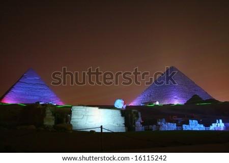 pyramids of giza and sphynx at night