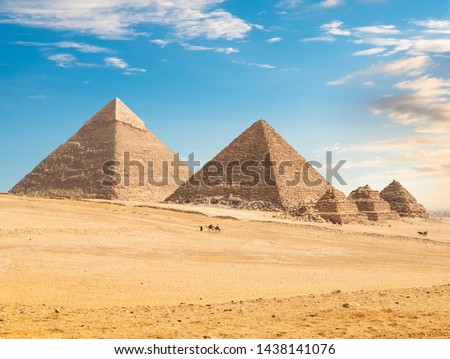 Pyramids of Giza in the desert by day
