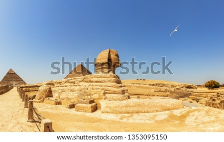 Pyramids of Giza panorama, view on the Sphinx, the Pyramid of Cheops and the Pyramid of Chephren