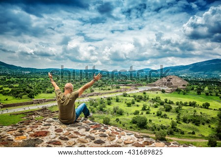 Pyramids of the Sun and the Moon on the Avenue of the Dead, Teotihuacan ancient city, old ruins of Aztec civilization, happy man enjoying traveling, Mexico, North America