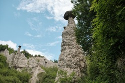 Pyramids of Zone Rock formations, also known as fairy chimneys, earth pyramids, hoodoos Monument rocks (Chalk Pyramids) of Zone at (ISEO) lake Lombardy Italy