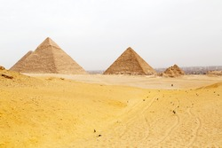 Pyramids on the Giza Plateau at Cairo, Egypt. The ancient structures form part of a UNESCO World Heritage Site.