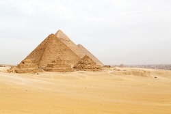Pyramids on the Giza Plateau at Cairo, Egypt. The ancient structures form part of the Memphis and its Necropolis – the Pyramid Fields from Giza to Dahshur UNESCO World Heritage Site.