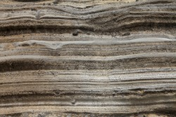 Pyroclastic deposit rock - Due to ancient volcanic activity, thick layers of sediment are formed along the coast of Jeju Island, Korea