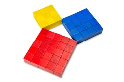Pythagorean theorem shown with colorful wooden cubes, side view. Pythagoras theorem. Relation of sides of a right triangle. The two smaller squares together have the same area than the big one. Photo.