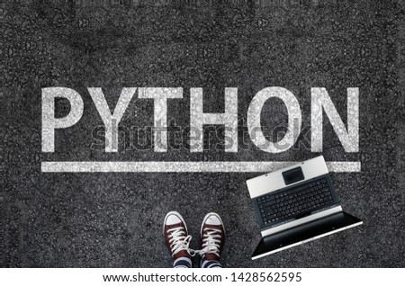 Python programming language.  man legs in sneakers standing next to laptop and word Python