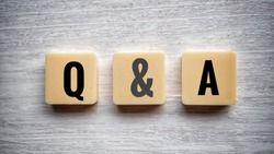 Q&A - question and answer shot form on wooden block