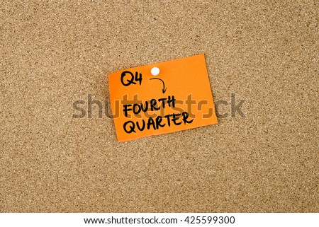 Q4 as FOURTH QUARTER written on orange paper note pinned on cork board with white thumbtacks, copy space available Foto stock ©