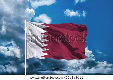 QATAR flag with sky background