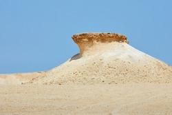 Qatar west coast. The Zekreet rock formations: strong winds blew away softer sedimentary rock, leaving behind the harder limestone