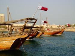 Qatari Flags on the Back of Old Boats (Dhows) - Doha, Qatar