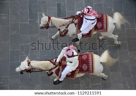 Qatari horse riders in traditional dress at Souq Waqif Doha Qatar