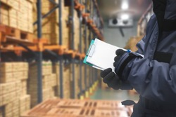 QC. worker checking goods on delivery in the cold room warehouse., Logistics food and beverage in cold storage concept